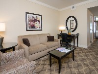 West Inn and Suites Double King Suite Living Area